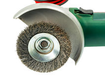 Wire wheel in angle grinder, on white background. Angle grinder with wire wheel installed Royalty Free Stock Images
