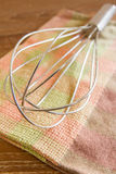 Wire whisk and cloth Royalty Free Stock Images