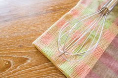 Wire whisk and cloth Royalty Free Stock Image