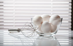 Wire whisk and eggs Stock Photography