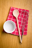 Wire whisk, wooden spoon and ceramic bowl. Stock Photo