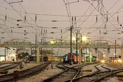 Wired. Train station with bridge trains and overhead lines maze Stock Photos