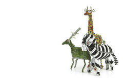 Wired And Beaded African Animal Craft Of A Zebra, Girafe And Buck Isolated On A White Background Stock Photos