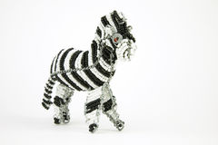 Wired and beaded African animal Craft of a Zebra isolated on a w Stock Image