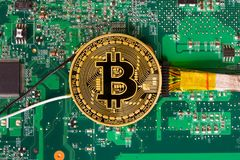 Wired bitcoin on motherboard Stock Images