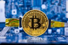 Wired bitcoin on motherboard Stock Photos