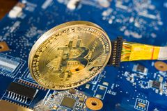 Wired bitcoin on motherboard Royalty Free Stock Images