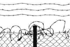 Wired fence. With barbed wires stock photos