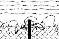 Wired fence. With barbed wires Stock Image
