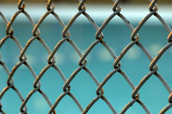 Wired fence. And swimming pool Royalty Free Stock Image