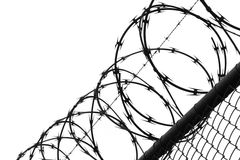 Wired fence with barbed wires Royalty Free Stock Photos