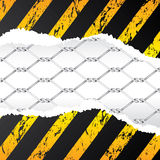 Wired fence behind ripped paper Royalty Free Stock Photo