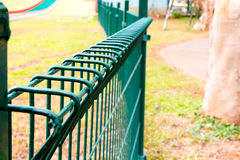 Wired fence in park Royalty Free Stock Photos