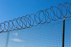 Wired Fence with Spiral Barbwire Stock Photography