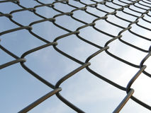 Wired mesh fence. In sky background Royalty Free Stock Photos