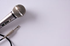 Wired microphone with connector on white table closeup top view Royalty Free Stock Photos