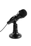 Wired Microphone On Stand. Wired black microphone on a stand isolated on white stock images