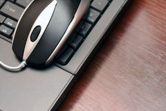 Wired mouse on keyboard Stock Photography