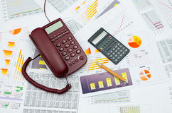 Wired phone and calculator. Wired telephone and scientific calculator on table royalty free stock photography