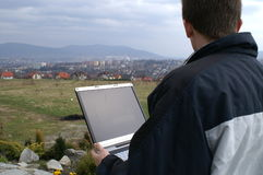 Wireles Internet over city. Laptop with with Internet internet over city Bielsko-Biala in Poland Stock Image