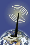 Wireless Adapter. Shown with a planet and signal strength symbol Royalty Free Stock Photo