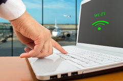 Wireless Airport. Businessman connecting to wi-fi at an airport Royalty Free Stock Photography