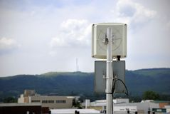 Wireless Antenna. E pointing to transmitters on a distant hill. Slight vignette added to emphasize the antenna Stock Photos