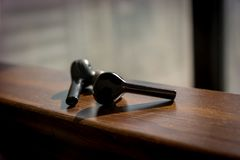 Wireless black earbuds on a wooden texture royalty free stock photos