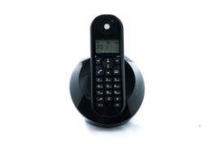 Wireless black telephone with cradle isolated on white background Royalty Free Stock Image