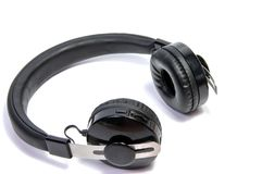 Wireless bluetooth headphone or earphone isolated. On white background Stock Photos