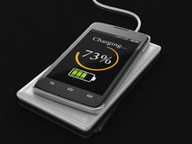 Wireless charging of smartphone (clipping path included) Royalty Free Stock Image