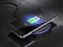 Wireless charging of smartphone Royalty Free Stock Photos