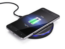 Wireless charging of smartphone Stock Photos