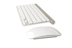 Wireless computer keyboard with the English alphabet and mouse. On white background Royalty Free Stock Photos