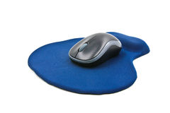 Wireless computer mouse on blue mouse pad Royalty Free Stock Photography