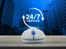Wireless computer mouse with button 24 hours service icon on woo stock image