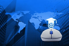Wireless computer mouse with e-learning icon over map and city t Stock Photography