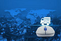 Wireless computer mouse with free delivery truck icon over map a Royalty Free Stock Image