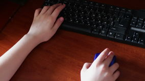Wireless computer mouse and keyboard used teenager stock video footage