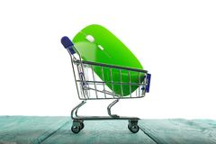 Wireless computer mouse in a miniature-shopping cart isolated on Royalty Free Stock Images