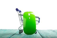 Wireless computer mouse in a miniature-shopping cart isolated on stock photos