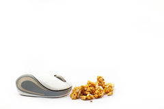 Wireless computer mouse and pop corn with white background Stock Image