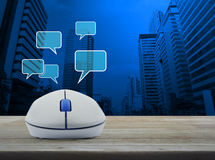 Wireless computer mouse with social chat sign and speech bubbles Royalty Free Stock Photography