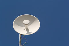 Wireless Dish Antenna. And blue sky with copy space Royalty Free Stock Photography