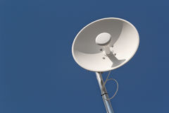 Wireless Dish Antenna. And blue sky with copy space Stock Photos