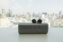 Free Wireless Earbud Headphones With Portable Speaker On Table For Music Stock Image - 118128701