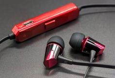 Wireless earphones on black background Stock Photo