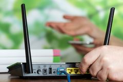 Wireless equipment, modern Wi-Fi router for Internet connection. On table Stock Photography