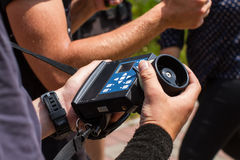 Wireless follow focus. Male hands hold the wireless follow focus system during the filming process Stock Images