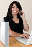 Wireless Freedom. A woman enjoys the freedom of wireless networking and phone calls Royalty Free Stock Image